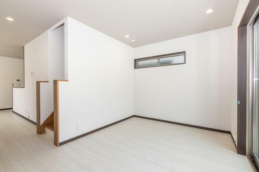 居間・リビング 家族の絆をギュギュっと深めるリビング階段を採用しています。