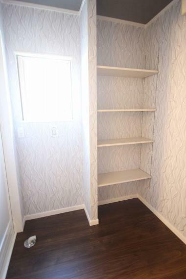 脱衣場 収納スペース付きの脱衣場
