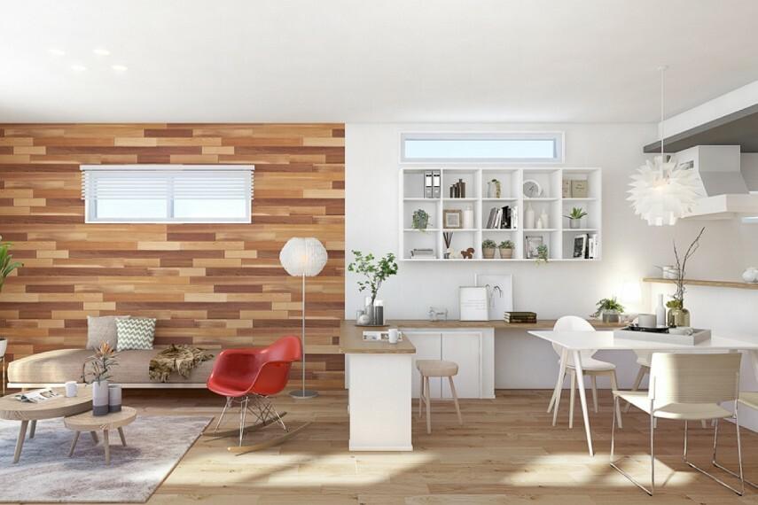 居間・リビング 【リビング+αの邸宅プラン】  自然の濃淡が美しい無垢材のウェスタンレッドシダーを採用したアクセントウォールなど、木のぬくもりを大切にしたインテリアが、ひときわ心地よい空間を演出しています。(2号棟完成予定図)