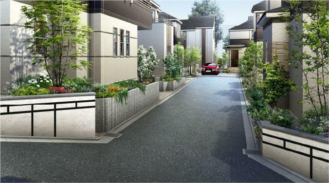 完成予想図(外観) 街区の入口を象徴的に仕上げた コーナーウォールを採用。 2つの街区内道路の入口には、象徴的なコーナーウォールを採用。建物のデザインと同調する濃い色のアルミのボーダーを縦横に組み合わせています。