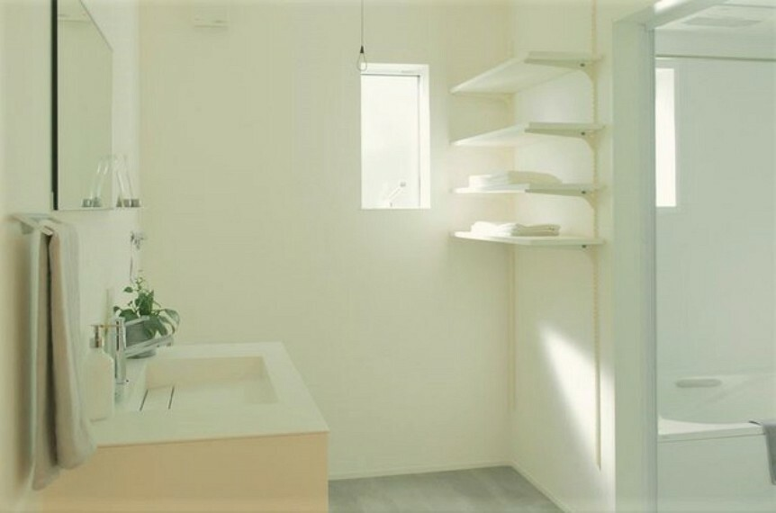 洗面化粧台 程よい空間の洗面・脱衣スペース。可動式のラック付きで使い勝手も良いですね。