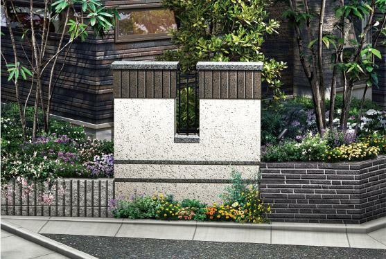 完成予想図(外観) 【街の景観を高めるコーナーウォール】 街の出入口のコーナーに、景観を高めるコーナーウォールを配置。美しい花々や樹木とともに街のアクセントを創出しています。隅切りによって、車の出入りがしやすいように配慮
