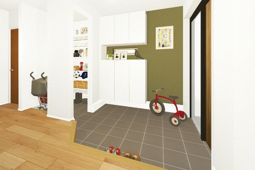 玄関 【広々土間玄関】  汚れの気になる自転車やアウトドア用品を置ける、広々とした土間のある玄関。自転車がそのまま入れるよう、玄関ポーチにはスロープを採用しています。/12号棟