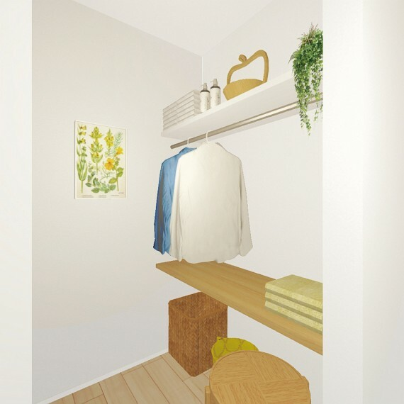 【ランドリーコーナー】  屋内干しや洗濯物の仮置きに便利なスペースを2階ホールにご用意しました。備え付けのカウンターで、洗濯物を畳んだり、アイロン掛けも可能です。(邸別)