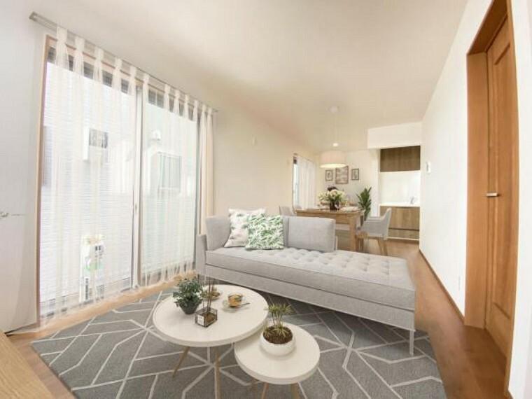 居間・リビング 1号棟リビング(配置してある家具はCGによるイメージです)光と風があふれる開放的なリビングダイニングには自然と家族みんなが集まってきます。