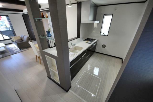 (当社分譲済施工例 キッチン)浄水器一体型のシステムキッチン、うれしい食器洗い乾燥機付きです